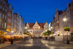 Long Market and Green Gate in Gdansk at dusk. View of people, restaurants, Green Gate and other old buildings at the Long Market, end of the Long Lane, at the Royalty Free Stock Photo