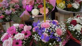 Long market rows with huge beautiful flower bouquets of various colors, business. Stock footage stock video footage