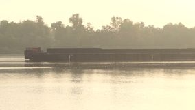 Long Metal Barge Floats Along The Dnipro With Trees in the Background. A Closeup of a Long Metal Barge Which Floats Along the Picturesque Dnipro With Trees in stock video