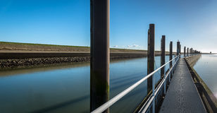 Long metal floating jetty in a canal Stock Photos