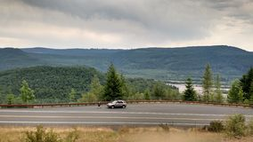 Long mountain. Big view little car Royalty Free Stock Images