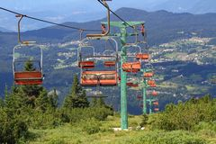 Long mountain chairlift in summer royalty free stock image