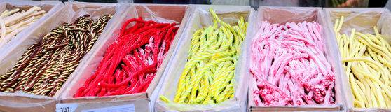 Long multicolored sweets (candies) on sale on the street. Street trade / market Stock Photography