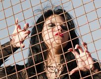 Long nailed woman in jail Royalty Free Stock Images
