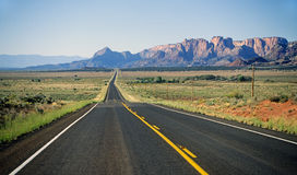 Long, narrow, desert road Stock Photography