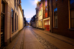 Long street at night in Groningen, Netherlands. Long narrow street at night in Groningen, Netherlands Royalty Free Stock Image