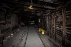 Long narrow wooden dusty industrial,shelter stock photo