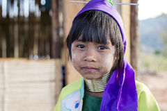 Long-Neck Child, Myanmar. Loikaw, Myanmar-January 23, 2016. A portrait of a young girl from the Padaung tribe (Karen). The ladies are famous for wearing large royalty free stock photos