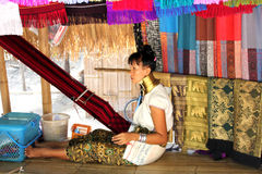 Long neck Karen. A long neck Karen tribe woman yarning in Chiang Mai cultural park, Thailand Royalty Free Stock Photo