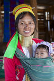 Long-Neck Woman, Myanmar. Loikaw, Myanmar-January 23, 2016. A portrait of a woman and baby from the Padaung tribe (Karen). The ladies are famous for wearing stock photos