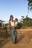 Long-Neck Woman, Myanmar. Loikaw, Myanmar-January 23, 2016. A portrait of a woman and child from the Padaung tribe (Karen). The ladies are famous for wearing stock images