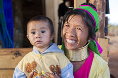 Long-Neck Woman, Myanmar. Loikaw, Myanmar-January 23, 2016. A portrait of a woman and child from the Padaung tribe (Karen). The ladies are famous for wearing royalty free stock image