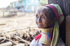 Long-Neck Woman, Myanmar. Loikaw, Myanmar-January 23, 2016. A portrait of a woman from the Padaung tribe (Karen). The ladies are famous for wearing large brass royalty free stock images