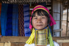 Long-Neck Woman, Myanmar. Loikaw, Myanmar-January 23, 2016. A portrait of a woman from the Padaung tribe (Karen). The ladies are famous for wearing large brass royalty free stock photography