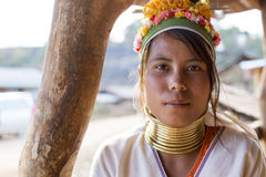 Long-Neck Woman, Myanmar. Loikaw, Myanmar-January 23, 2016. A portrait of a woman from the Padaung tribe (Karen). The ladies are famous for wearing large brass royalty free stock photos
