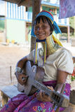 Long-Neck Woman, Myanmar. Loikaw, Myanmar-January 23, 2016. A portrait of a woman playing a guitar from the Padaung tribe (Karen). The ladies are famous for stock images