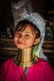 Long Neck Woman. A portrait of a young woman from the Long Neck Karen Hilltop tribe outside Chiang Mai, Thailand. The people from the tribe are refugees from stock photos