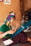 Long neck woman weaving Stock Image