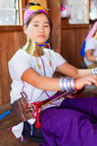 Long neck woman weaving Stock Photo