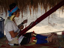 Long neck woman weaving. Stock Photos