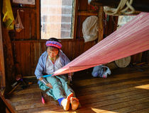 A long-neck woman worrking at the house in Inlay Lake, Myanmar Royalty Free Stock Image