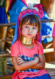 Long-necked Kayan girl in Thailand. PAI, THAILAND - NOV 23, 2016: Long-necked  Kayan girl in the Ban Huay Pa Rai Hill Tribe Village near Pai, Thailand Royalty Free Stock Photo