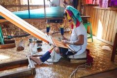 Long necked Kayan Padaung woman weaving Royalty Free Stock Photo