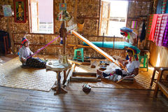 Long necked Kayan Padaung woman weaving Royalty Free Stock Images