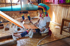 Long necked Kayan Padaung woman weaving Stock Image