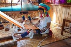 Long necked Kayan Padaung woman weaving Stock Image