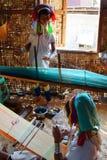 Long necked Kayan Padaung woman weaving Stock Images
