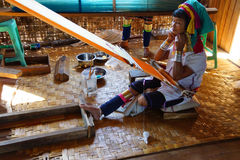 Long necked Kayan Padaung woman weaving Royalty Free Stock Image