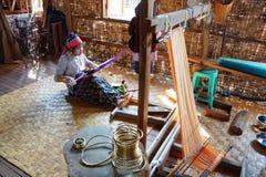 Long necked Kayan Padaung woman weaving Stock Photo