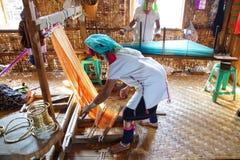 Long necked Kayan Padaung woman weaving Royalty Free Stock Photos