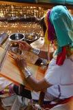 Long necked Kayan Padaung woman weaving Royalty Free Stock Images