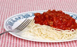 Long noodle spaghetti with meat sauce and a fork Royalty Free Stock Photo