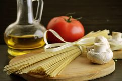 Long noodles, mushrooms,tomato Royalty Free Stock Images