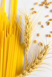 Long noodles. Spikelets of wheat Stock Image