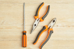 A long nose pliers, driver and a pliers Stock Images