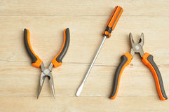 A long nose pliers, driver and a pliers Royalty Free Stock Photos