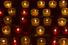 Long numbers of candles. Candles in memory about died in a cathedral of Marseilles Royalty Free Stock Images