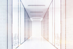 Long office corridor with glass walls. There are several conference rooms in it and. Stock Photography