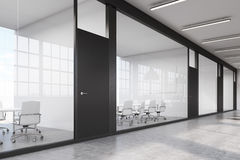 Long office corridor with a row of conference rooms Royalty Free Stock Photo