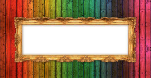 Long old golden frame over colorful wooden wall Stock Photography