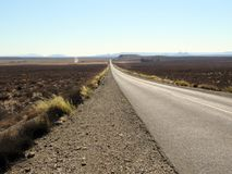Long open road through the Karoo, South Africa Stock Images