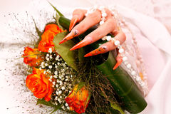 Long orange artificial bridal nails Royalty Free Stock Photo
