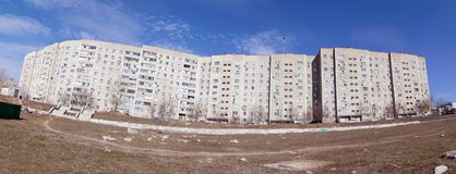 Long panel house of a modern city. Long panel house in the modern city. Panorama shot Royalty Free Stock Photo