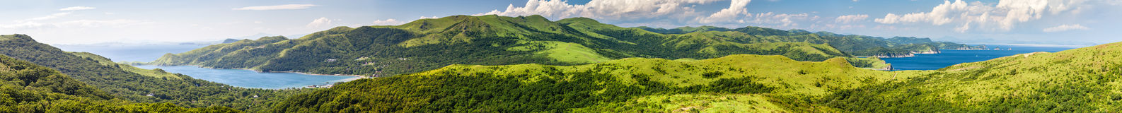 Long panorama of the Russian resort area of the Sea of Japan. With hills and greenery in summer sunny day royalty free stock image