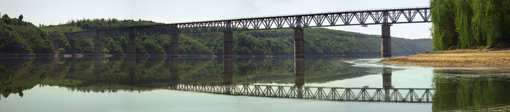 Long panoramic bridge over the river royalty free stock photos