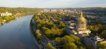 Long Panoramic View Charleston West Virginia Capitol City. Sunrise reflects in the Kanawha River slowly flowing by picturesque Charleston West Virginia downtown royalty free stock image